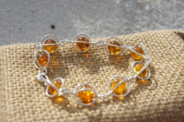Amber bracelet handmade in Poland. 9 floating cognac Amber stones 2