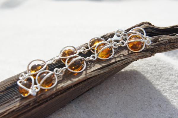 Amber bracelet handmade in Poland. 9 floating cognac Amber stones