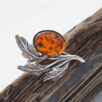 Amber brooch with cognac amber