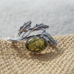 Amber brooch with green amber