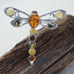 Amber dragonfly brooch with multicolor amber